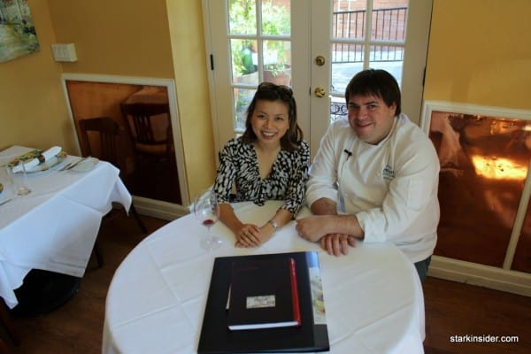 Loni Kao Stark enjoys an early morning '04 Freemark Abbey Merlot while Chef Josiah Slone talks about his craft.