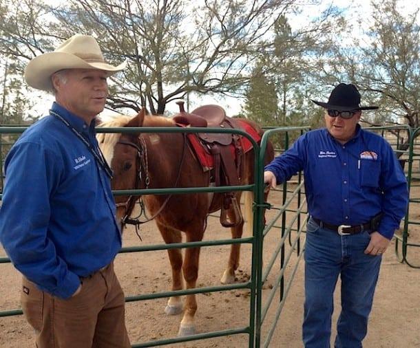 Pastor Randy, the horse-whisper, is on the left