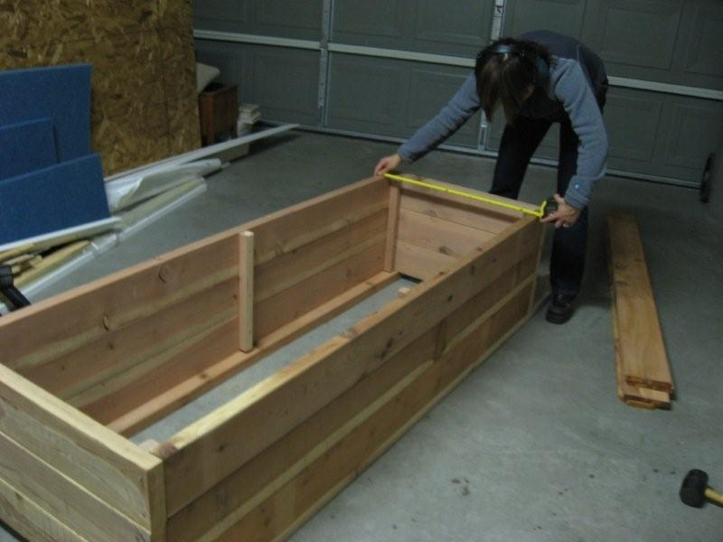 Measuring wood from Home Depot to build a planter box