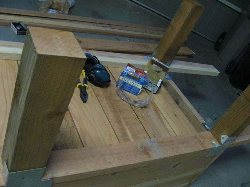 Legs on a DIY wooden vegetable planter box